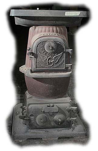 Caboose Pot Belly Stove http://www.antique-cast-iron-stoves.com/caboose_laundry_stoves/7-01_smoke_consumer.php