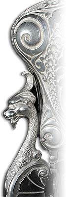 Photo of a wyvern detail on a parlor heater.